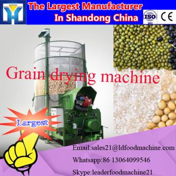 Microwave machine for drying sesame seeds